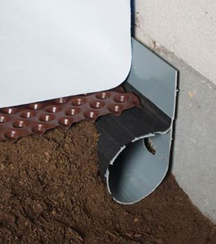 Closeup of a crawl space drainage system installed in Buhl