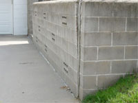 A retaining wall separating from the adjoining walls in Preston