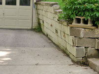 a failing retaining wall around a driveway in Boise