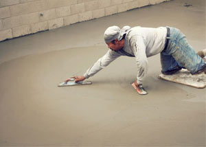 smoothing out the grout in a slab releveling project in Caldwell