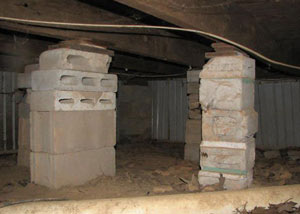 crawl space repairs done with concrete cinder blocks and wood shims in a Burley home