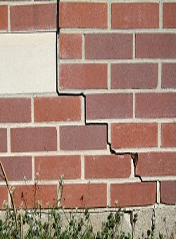 photo of a rotating foundation wall with cracks in Buhl