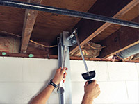 Straightening a foundation wall with the PowerBrace™ i-beam system in a Post Falls home.