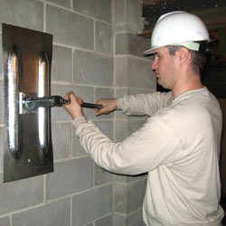 installing a wall anchor to repair an bowing foundation wall in Post Falls