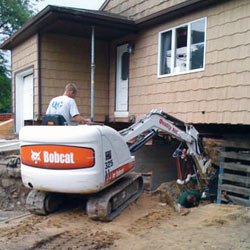 Excavating to expose the foundation walls and footings for a replacement job in Rexburg