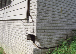 A severely damaged foundation wall in Lewiston
