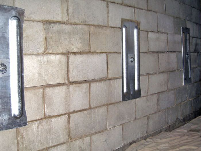An Inside View Of Foundation Wall Anchors Installed Along A Bat To Brace And Repair