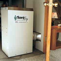 A basement dehumidifier with an ENERGY STAR® rating ducting dry air into a finished area of the basement  in Payette