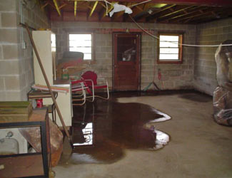 a flooded basement floor in a Payette home